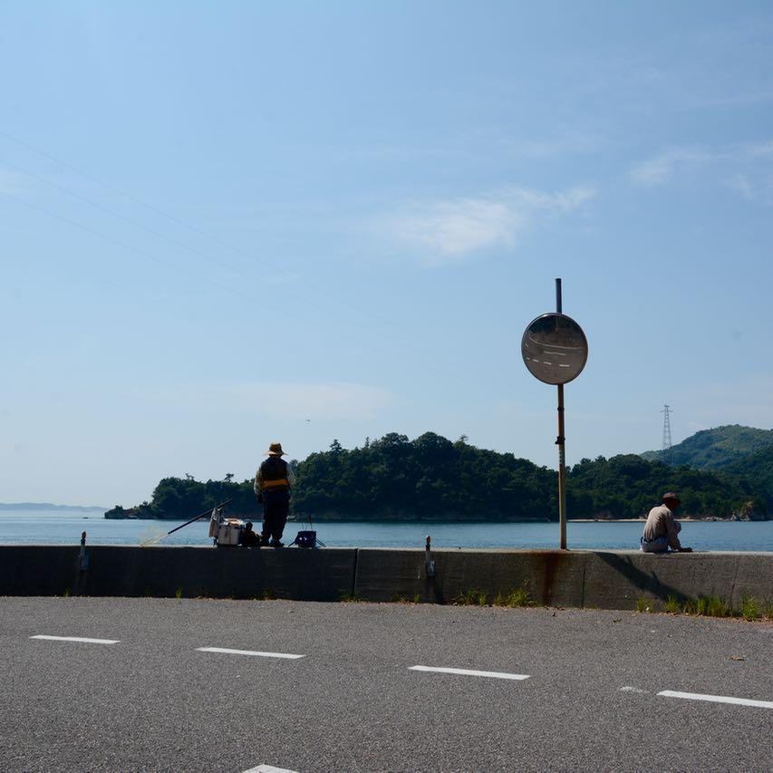 shimanami kaido cycling seto inland sea oshima fisher