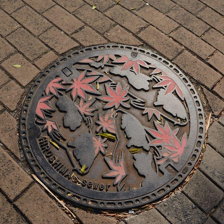 Hiroshima city manhole cover autumn leaves