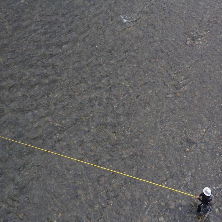 tama river cycling fisherman