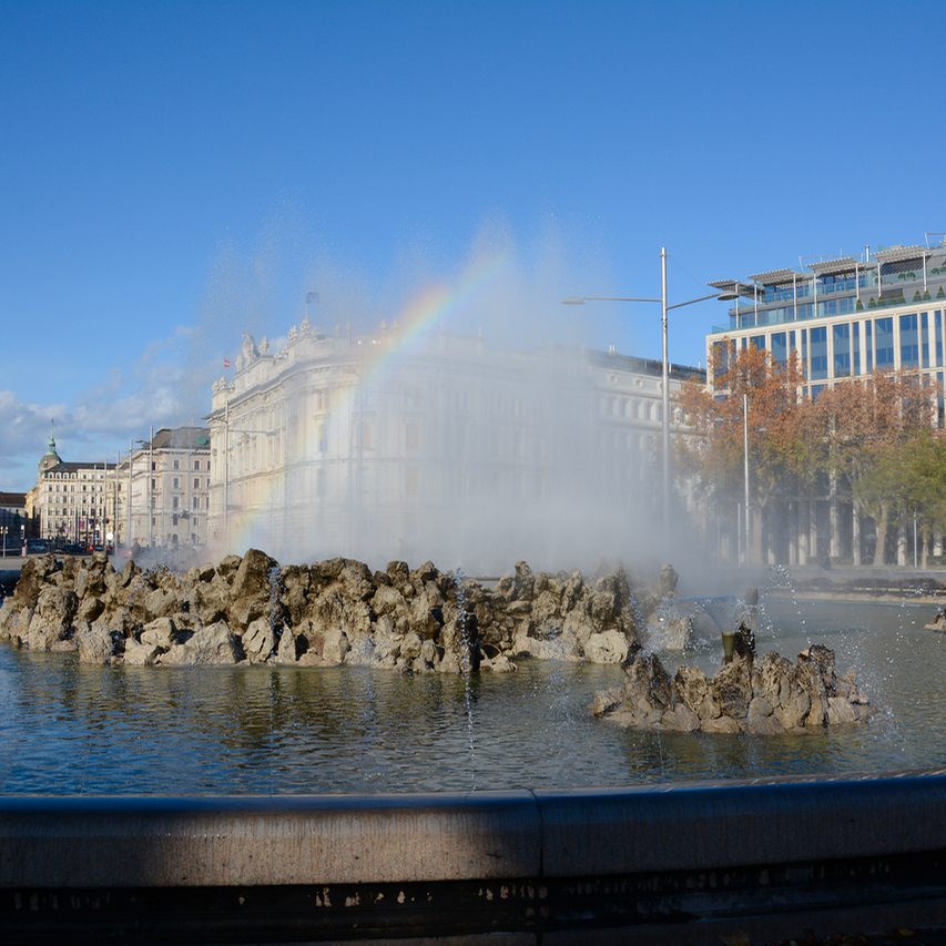 Vienna Wien Austria with children kids fountain rainbow