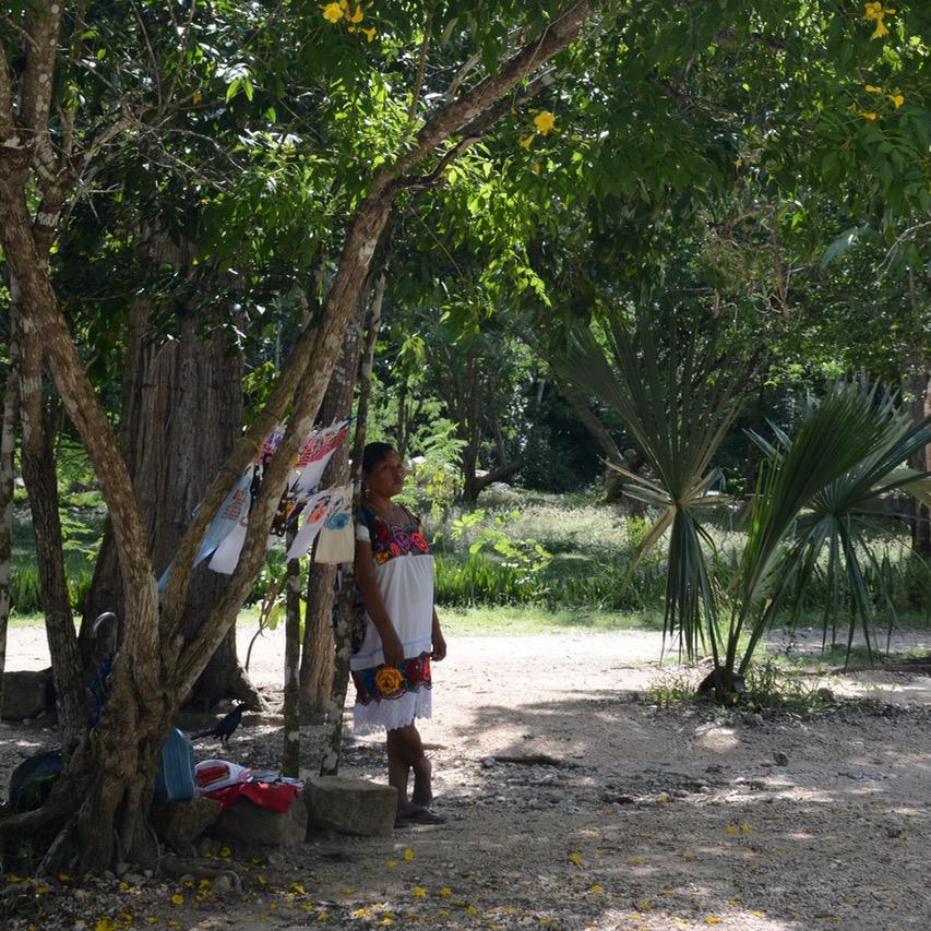travel with children kids mexico chichen itza souvenir vendor