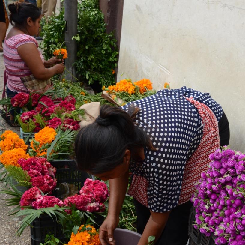 Mexico Merida travel with children kids flower woman