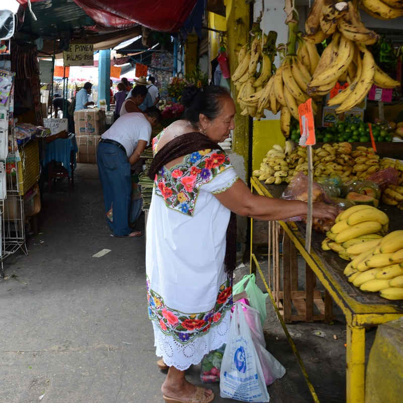Mexico Merida travel with children kids bananas