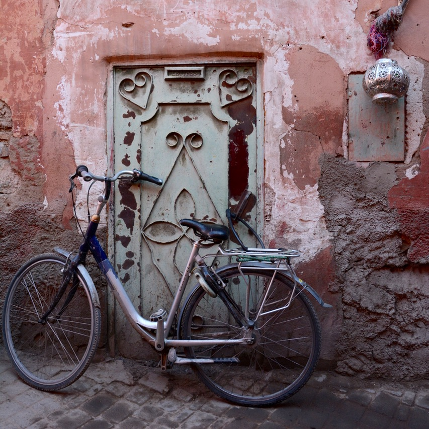 Travel with children kids Marrakesh morocco medina bike