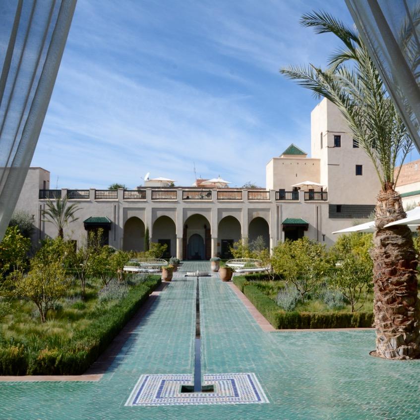 Travel with children kids Marrakesh morocco medina secret garden water garden