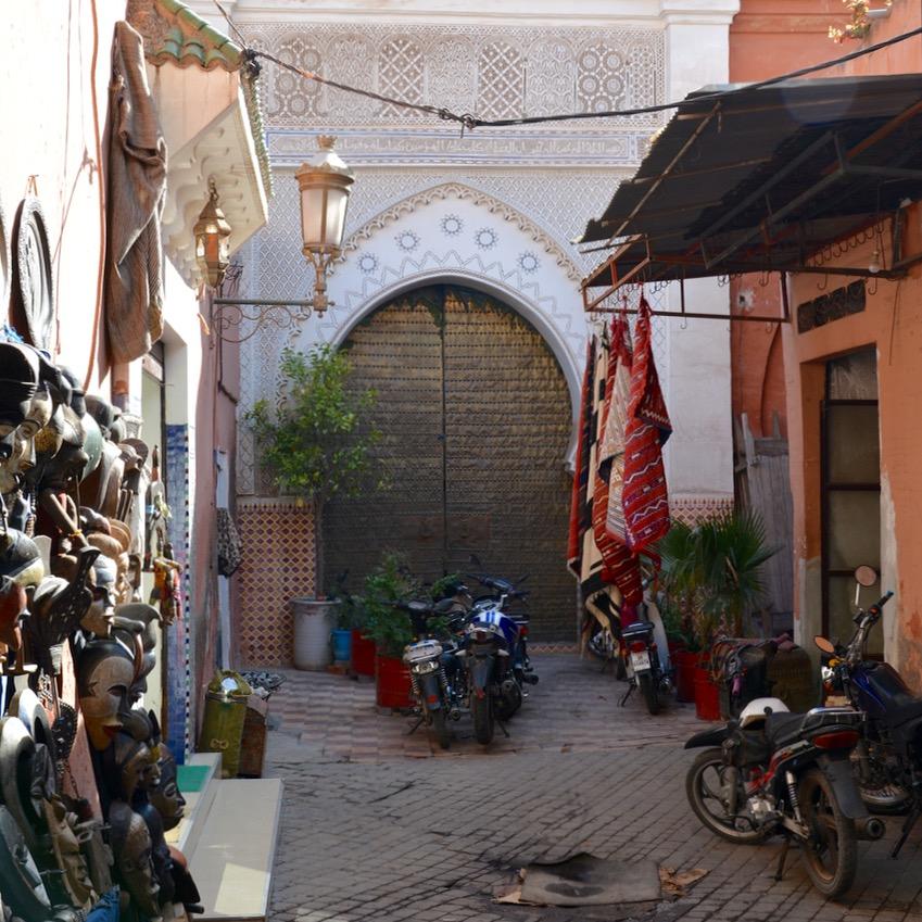 Travel with children kids Marrakesh morocco medina secret garden side street
