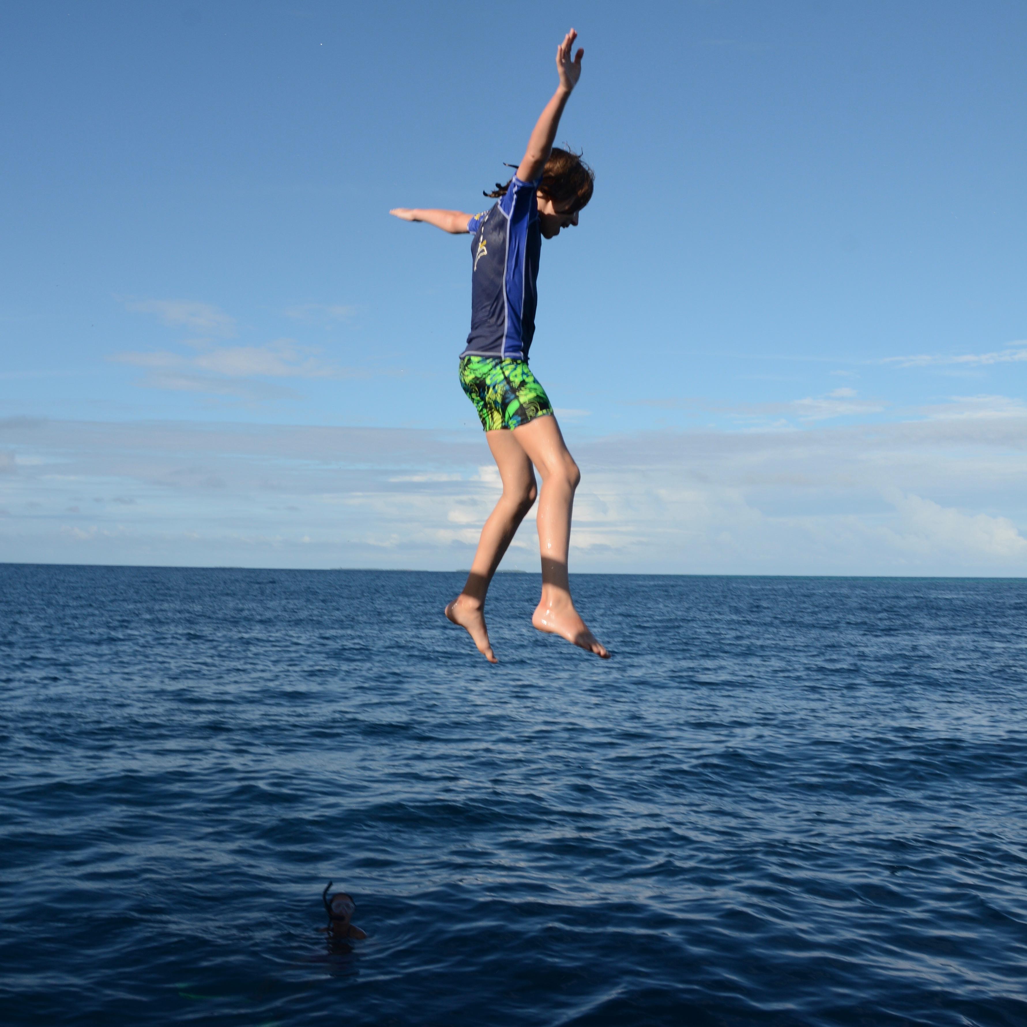 travel with children kids maldives lux south ari atoll jump