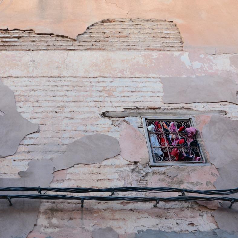 Travel with children kids Marrakesh morocco medina spice souk window