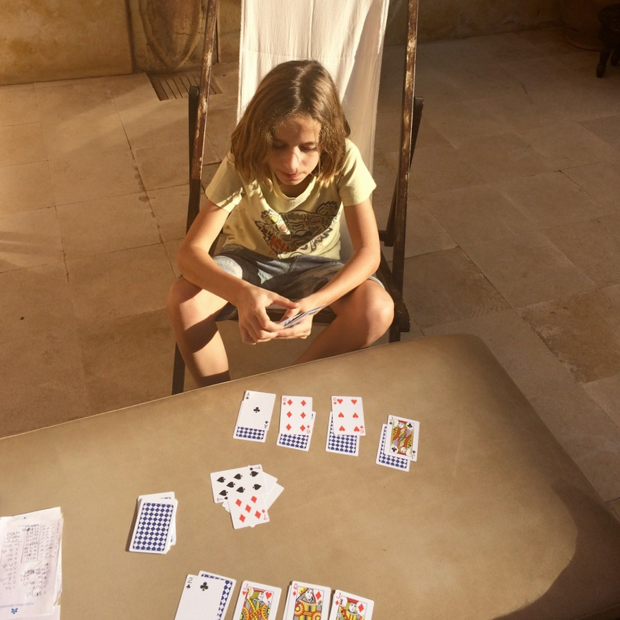 travel with kids children morocco marrakech hotel caravanserai card games