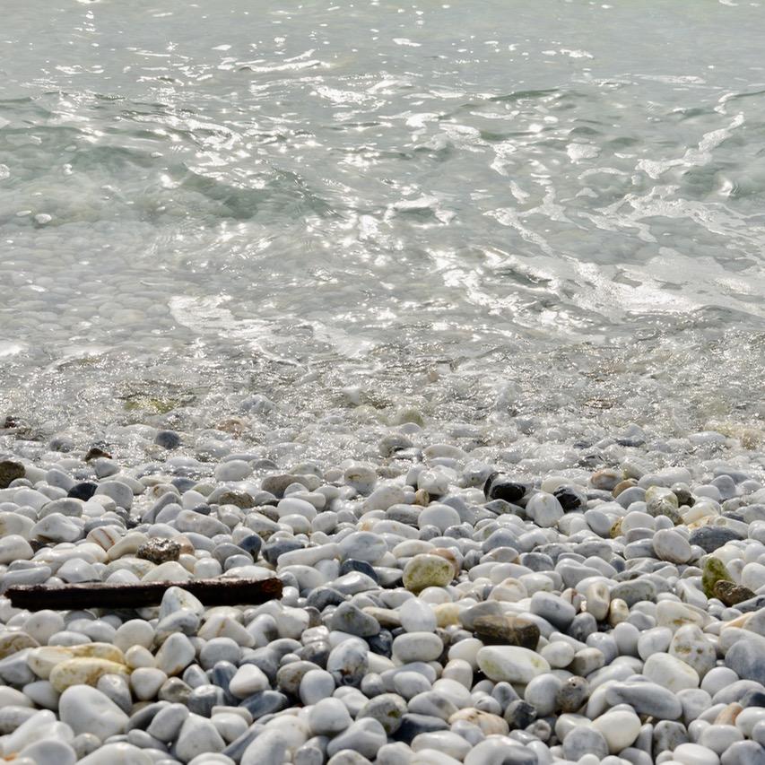 travel with kids children pisa italy marina di pisa beach pebbles