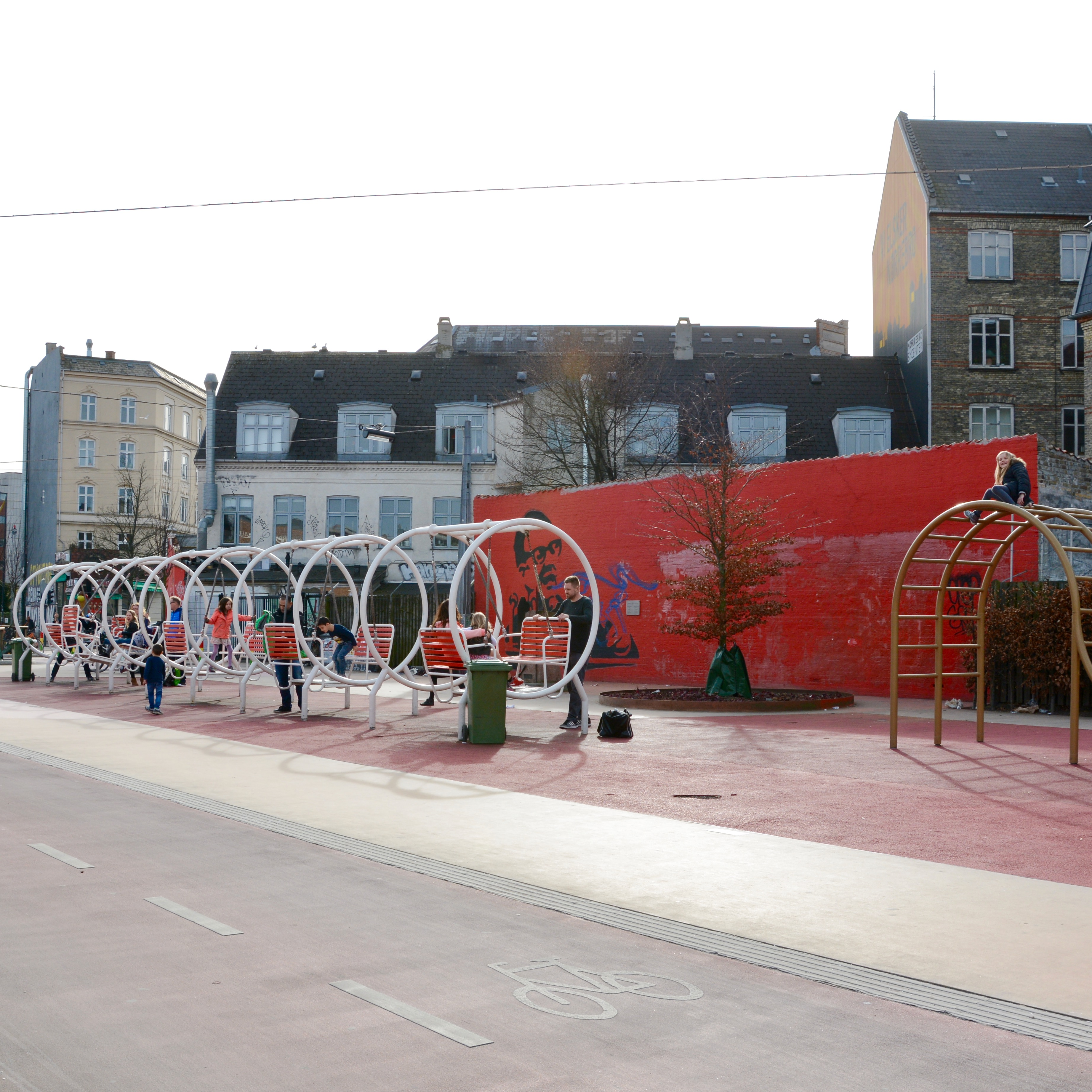 travel with kids children Copenhagen Denmark norrebro superkilen park swings