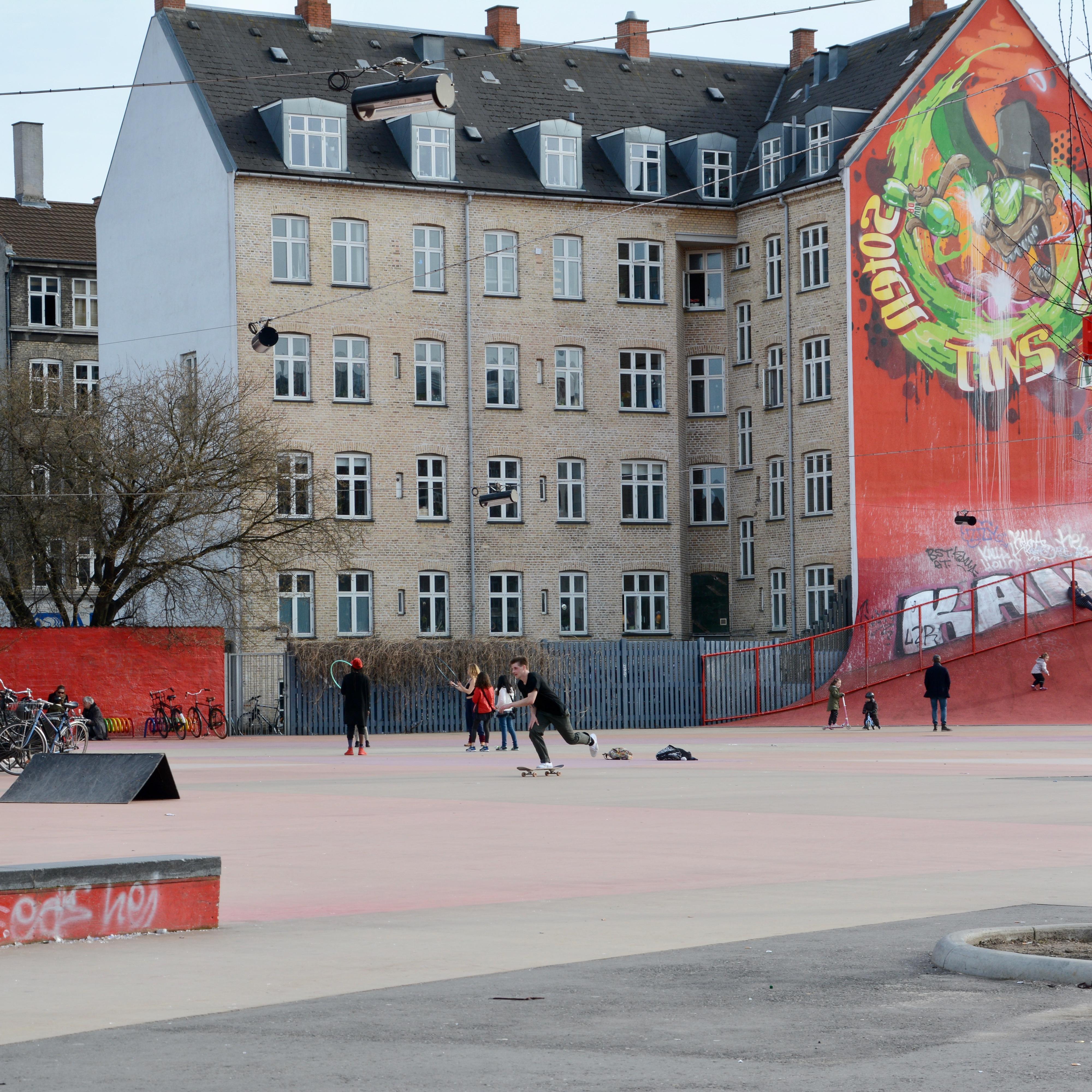 travel with kids children Copenhagen Denmark norrebro superkilen park skaters