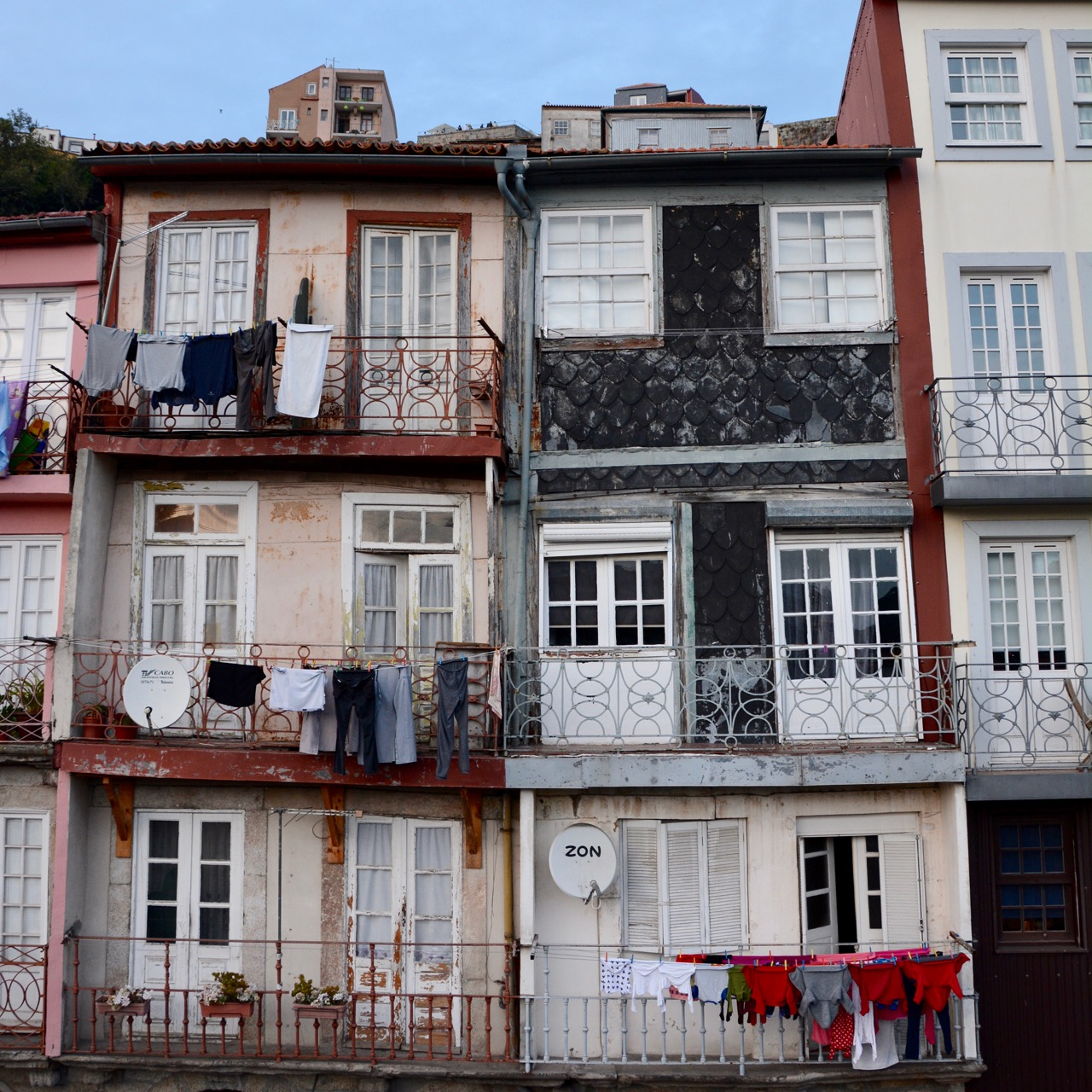 travel with kids children porto portugal town houses washing line