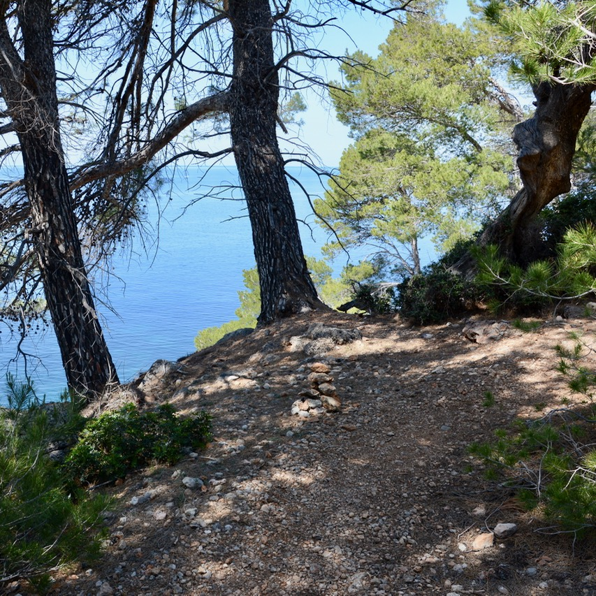 travel with kids children soller mallorca spain coastal hike ben's d'avall to cala deia stone marker